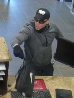 "Suspect #1 is described as a White male in his late 20's or early 30's, 6'0″– 6'4"" tall, approximately 210 pounds, with a medium build, light complexion, and short, blonde hair. He has worn a sweatshirt or jacket in each robbery with a ball cap or sunglasses to conceal his identity. Suspect was armed with a handgun."