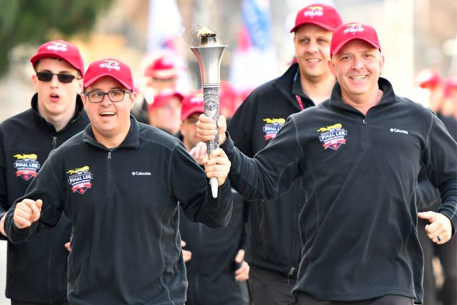Cpl. Dawson carrying the Special Olympic Torch: The Flame of Hope.