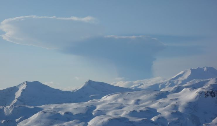 An ash cloud from the erupting Bogoslof volcano seen from nearby Unalaska island
