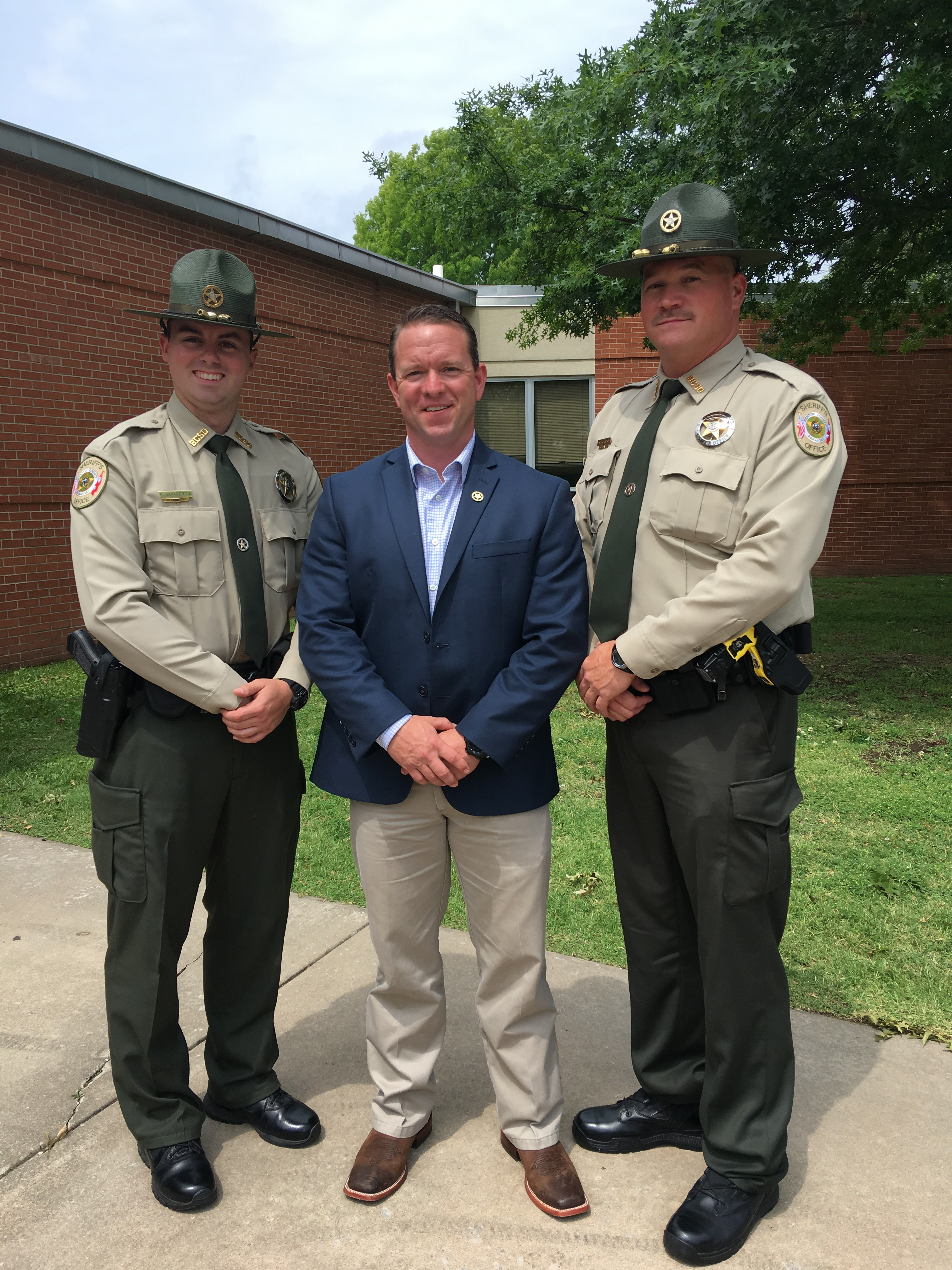 Richard Surrente, Sheriff Shawn Holloway and Andrew Gregory