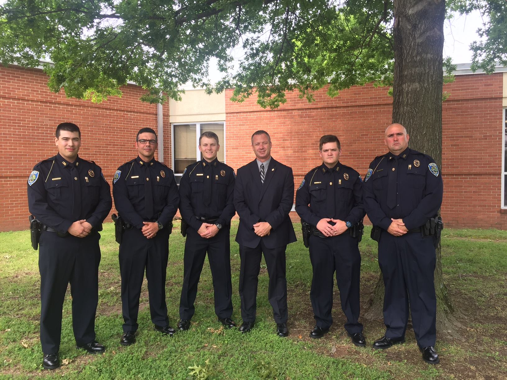 Officer Cody McAbee, Officer Andrew Byrnes, Officer Dylan Weisenfels, Deputy Chief of Police Mike Reynolds, Officer Page Summers, and Officer Justin Harlan.