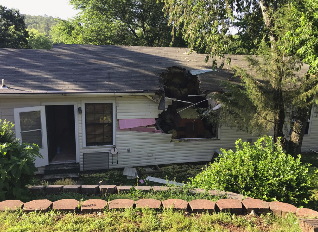 2 hurt after street sweeper crashes into Benton County home