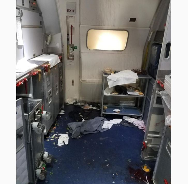 Unruly Delta passenger tried to open exit door in flight, complaint alleges