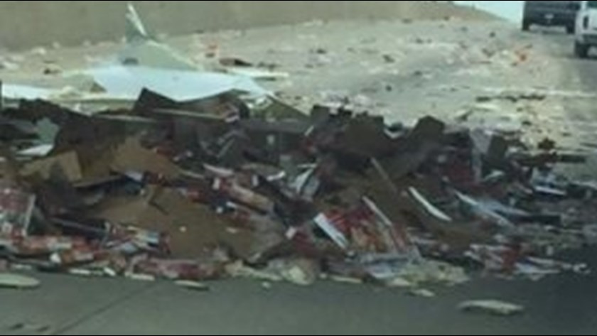 PIZZA! 18-wheeler strikes overpass, spilling hundreds of frozen pies