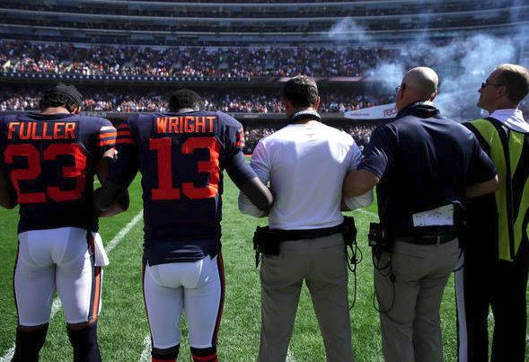 he Chicago Bears lock arms for the national anthem prior to the game against the Pittsburgh Steelers at Soldier Field on September 24, 2017 in Chicago, Ill. (Getty Images).