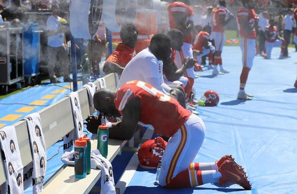 Justin Houston of the Kansas City Chiefs takes a knee during the National Anthem before the game against the Los Angeles Chargers at the StubHub Center on September 24, 2017 in Carson, Calif. (Getty Images).
