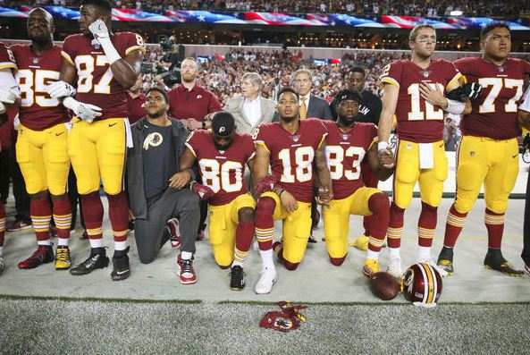 Washington Redskins players during the the national anthem before the game against the Oakland Raiders at FedExField on September 4, 2017 in Landover, Maryland. (Getty Images).