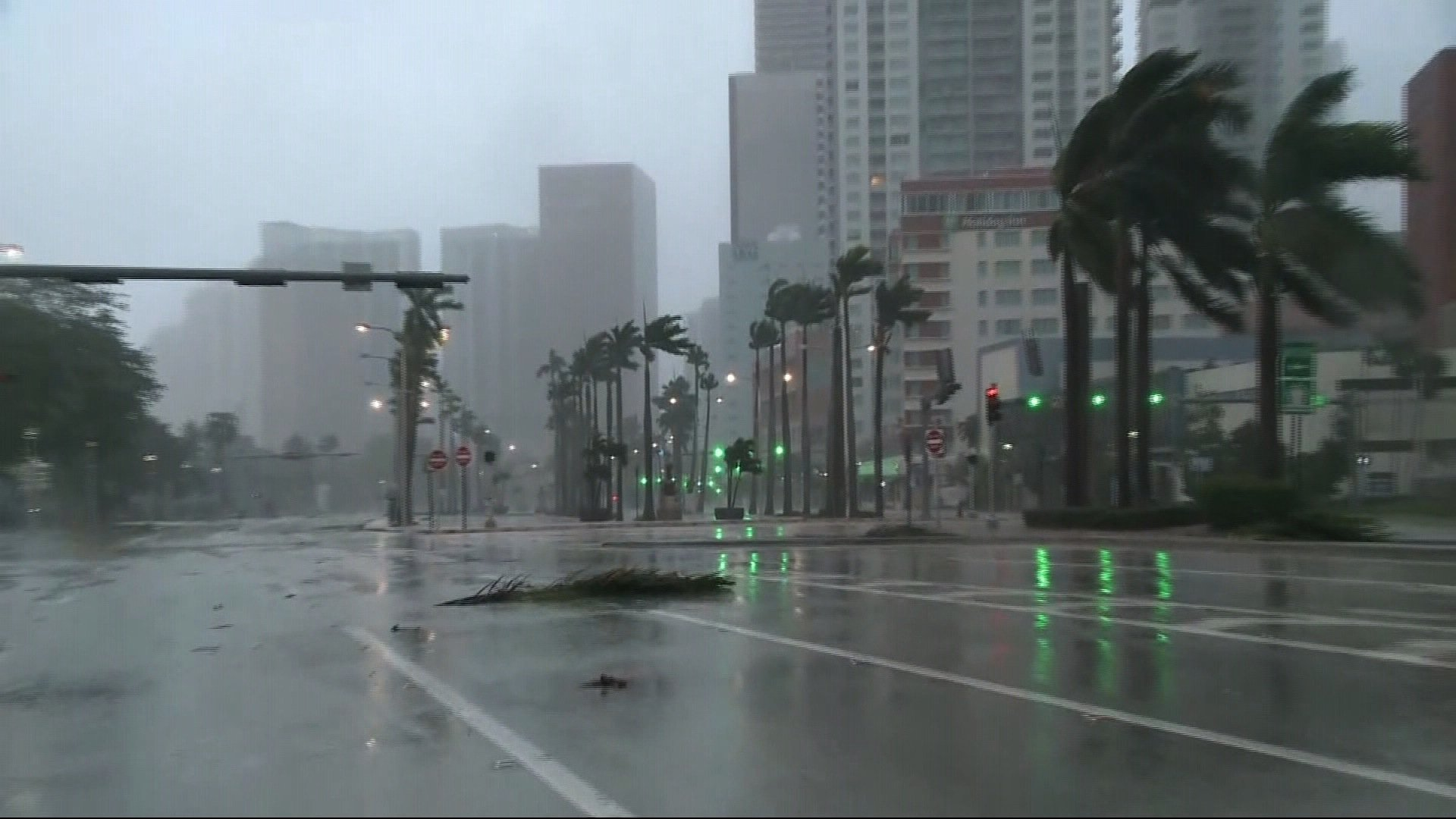 Skies darken and rain batters Miami Florida