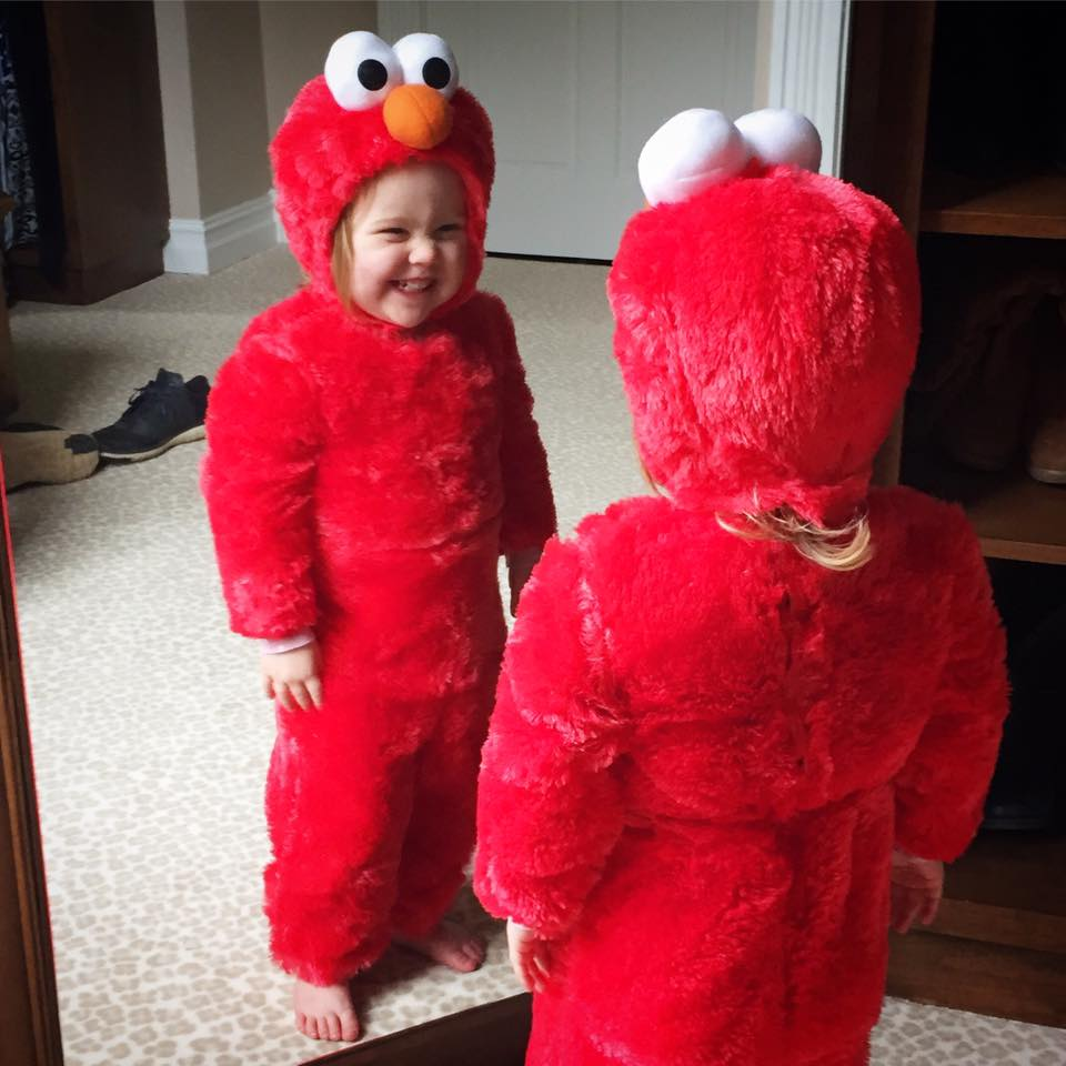 Blakely Grey tries on her Elmo costume. Photo sent in by Dianna Elkins.