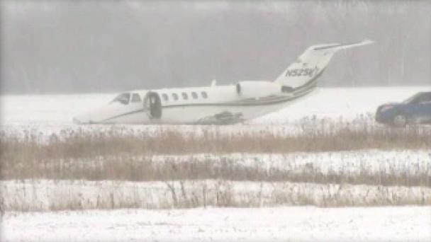 Plane Slides Off Runway, Crashes Through Fence