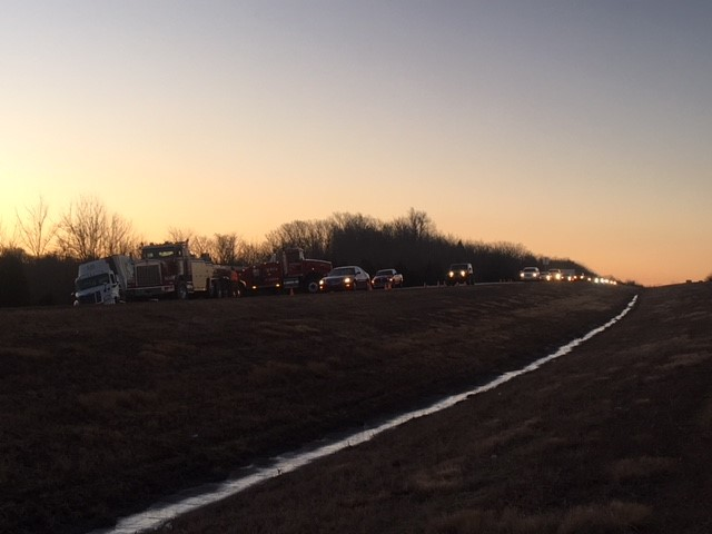 Traffic backs up after semi roll-over accident on I-49.