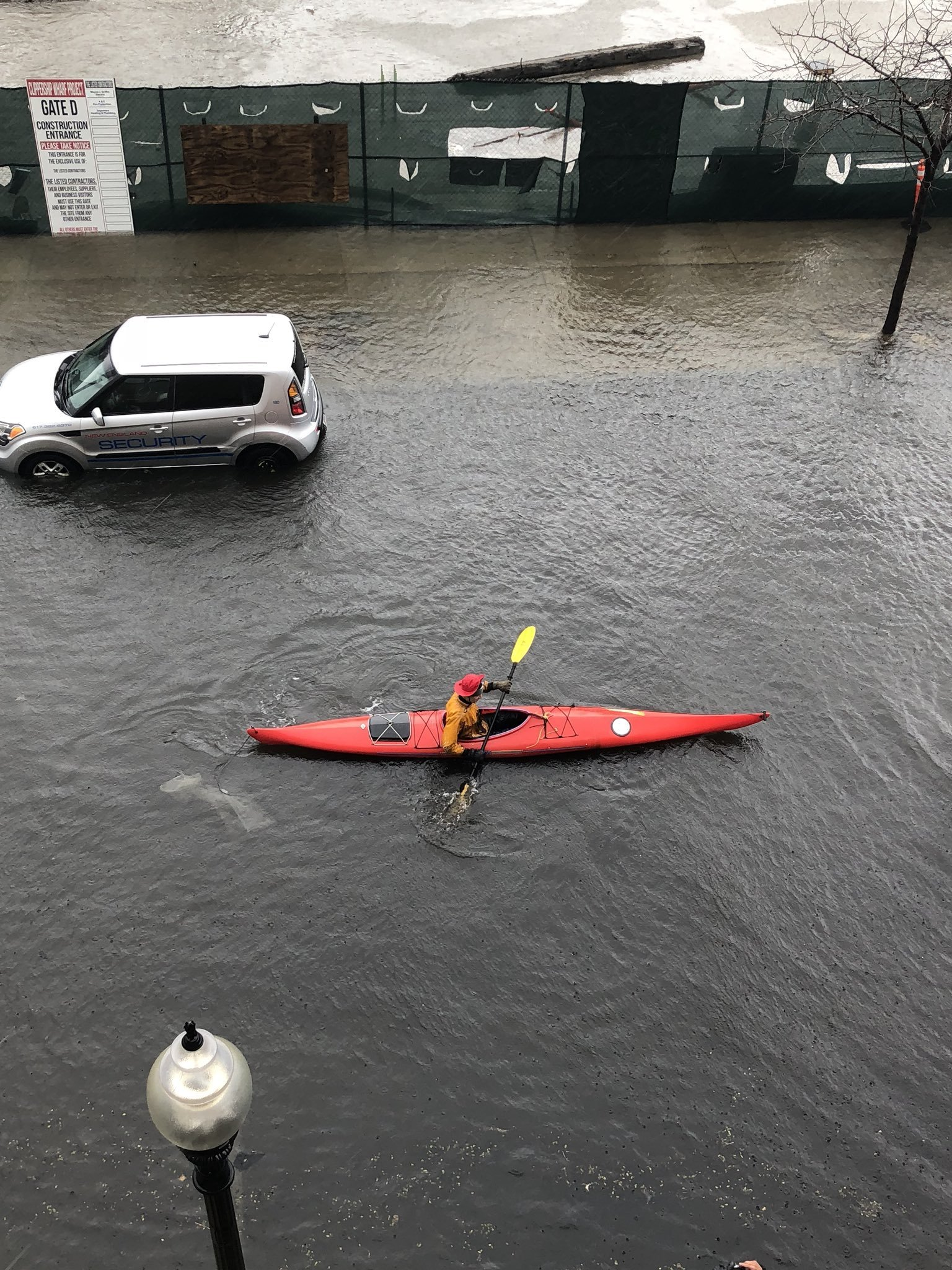 Seen here is flooding on March 2, 2018 in East Boston. A kayaker is seen here paddling down this flooded street.