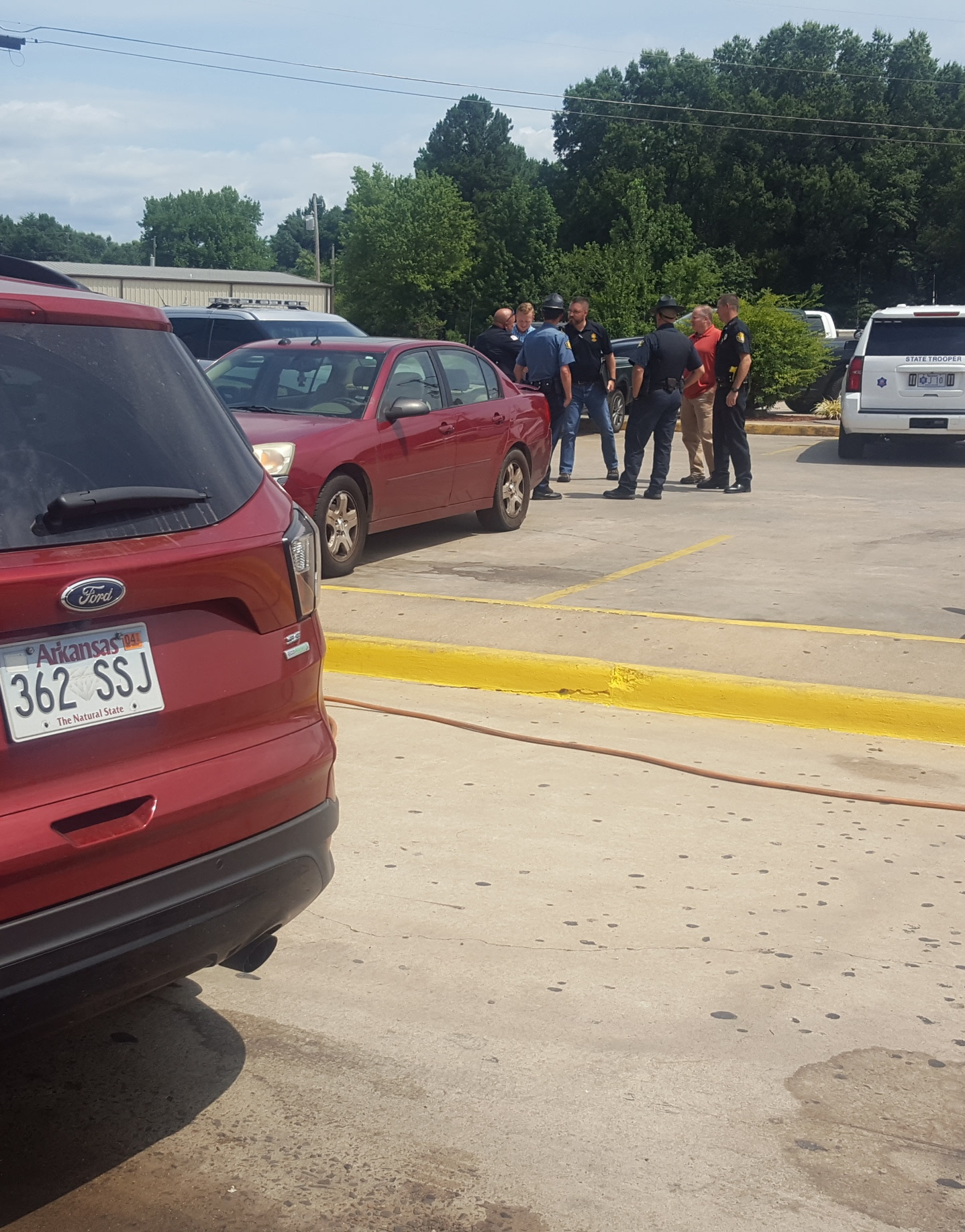 The car was found in Atkins at the VP/McDonald's convenience store at Interstate 40.