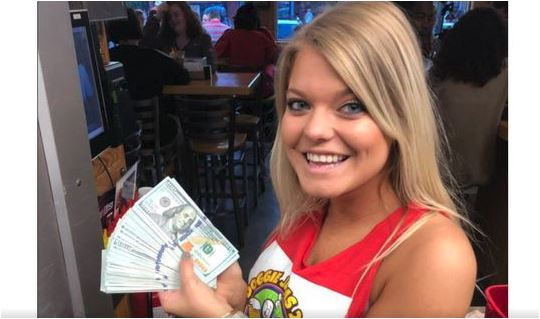 Customer orders two waters and leaves $10,000 tip