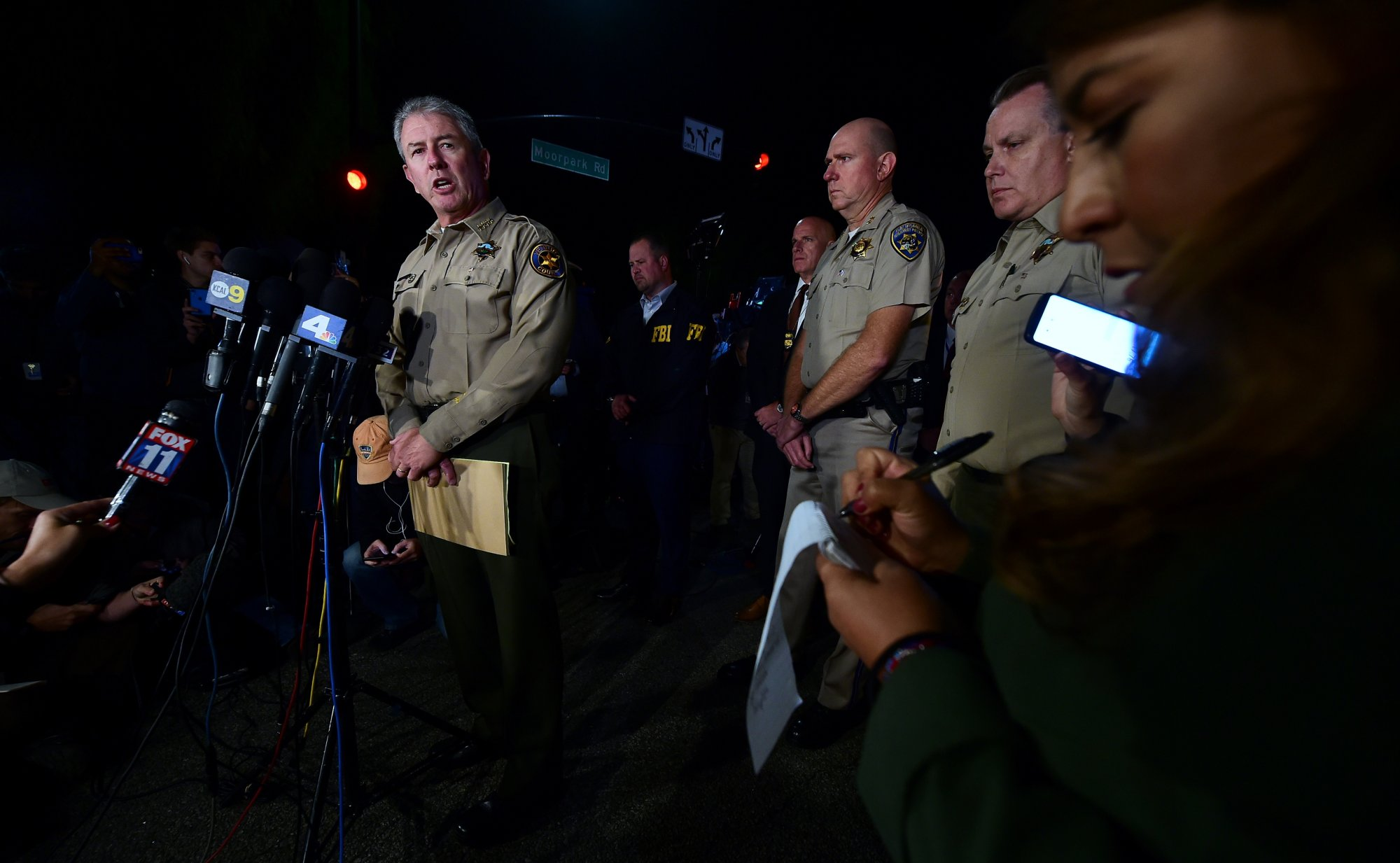 Ventura County Sheriff Geoff Dean briefs reporters at the intersection of US 101 freeway and the Moorpark Rad exit as police vehicles close off the area responding to a shooting at a bar in Thousand Oaks, California on November 8, 2018. - Twelve people, including a police sergeant, were shot dead in a shooting at a nighttclub close to Los Angeles, police said Thursday. All the victims were killed inside the bar in the suburb of Thousand Oaks late on Wednesday, including the officer who had been called to the scene, Sheriff Geoff Dean told reporters. The gunman was also dead at the scene, Dean added. The bar was hosting a college country music night. (Photo by Frederic J. BROWN / AFP)        (Photo credit should read FREDERIC J. BROWN/AFP/Getty Images)
