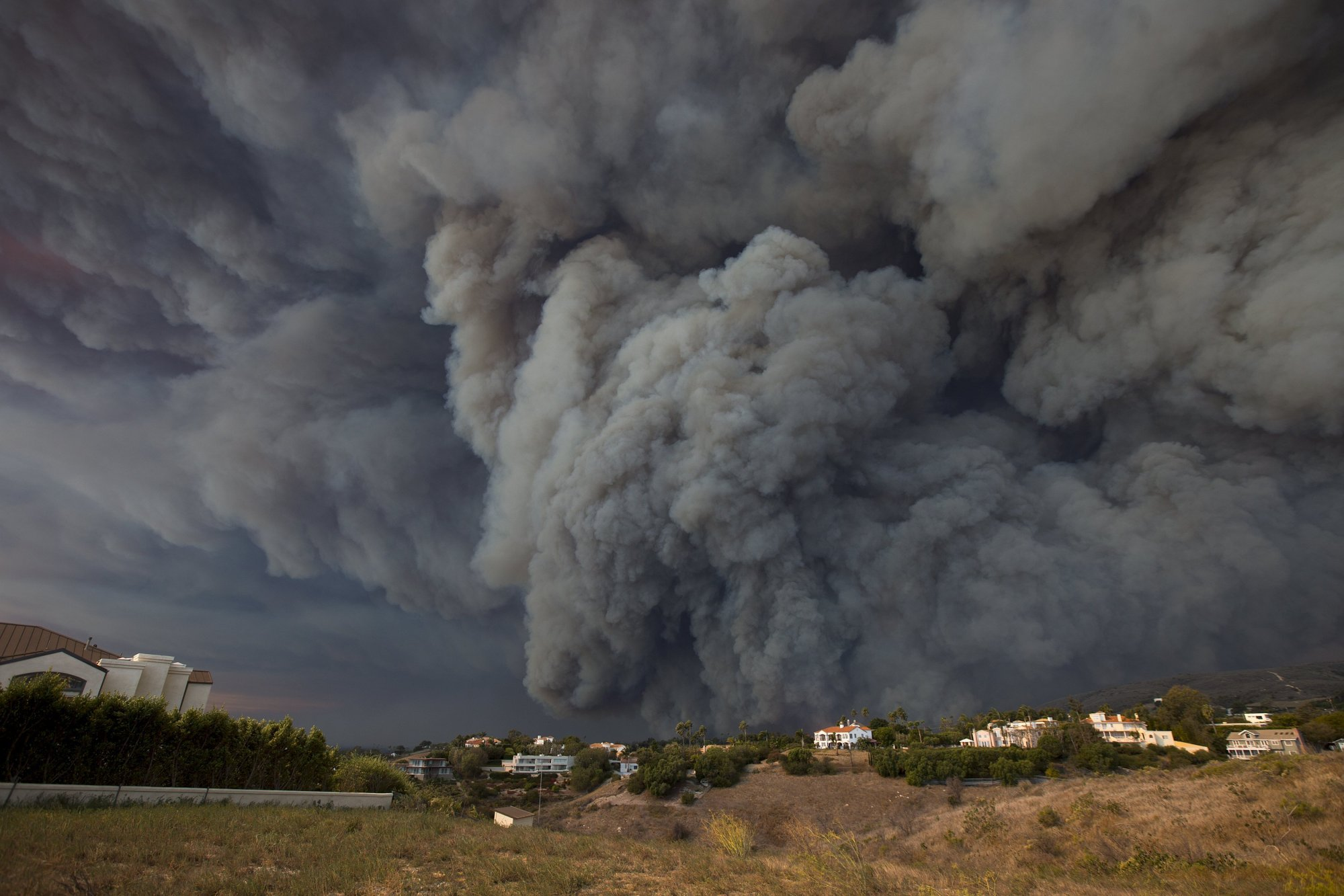 A massive smoke plume, powered by strong winds, rises above the the Woolsey Fire on Friday in Malibu