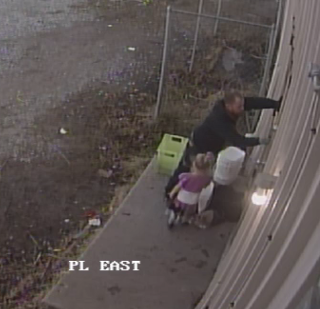 Suspect Caught On Camera Breaking Into Business With Child In Tow