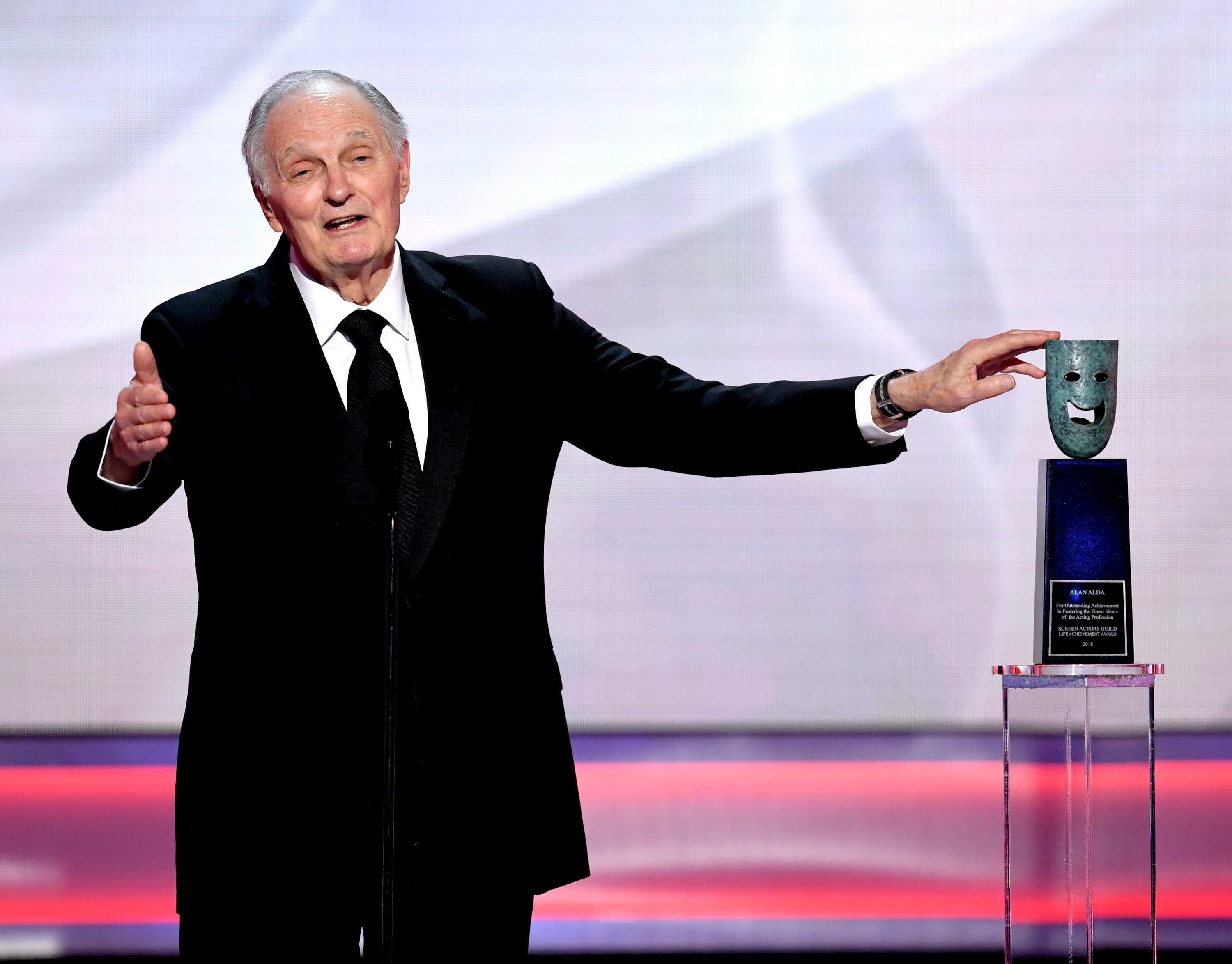 LOS ANGELES, CALIFORNIA - JANUARY 27: Alan Alda receives the SAG Life Achievemant Award onstage during the 25th Annual Screen Actors Guild Awards at The Shrine Auditorium on January 27, 2019 in Los Angeles, California. (Photo by Kevin Winter/Getty Images for Turner)
