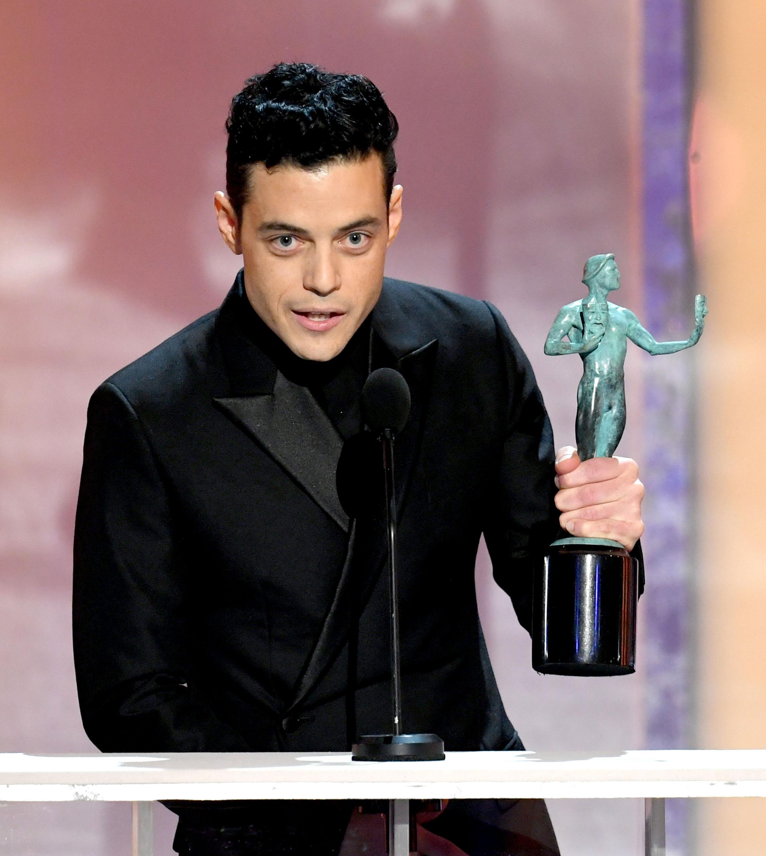 "LOS ANGELES, CALIFORNIA - JANUARY 27: Rami Malek accepts Outstanding Performance by a Male Actor in a Leading Role for ""Bohemian Rhapsody"" onstage during the 25th Annual Screen Actors Guild Awards at The Shrine Auditorium on January 27, 2019 in Los Angeles, California. (Photo by Kevin Winter/Getty Images for Turner)"