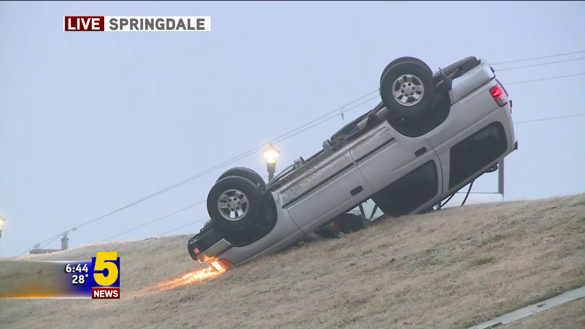 A rollover wreck took place at the Don Tyson Parkway and Interstate 49 early Thursday (Feb. 28) after freezing drizzle left overpasses slick. The driver was unhurt.