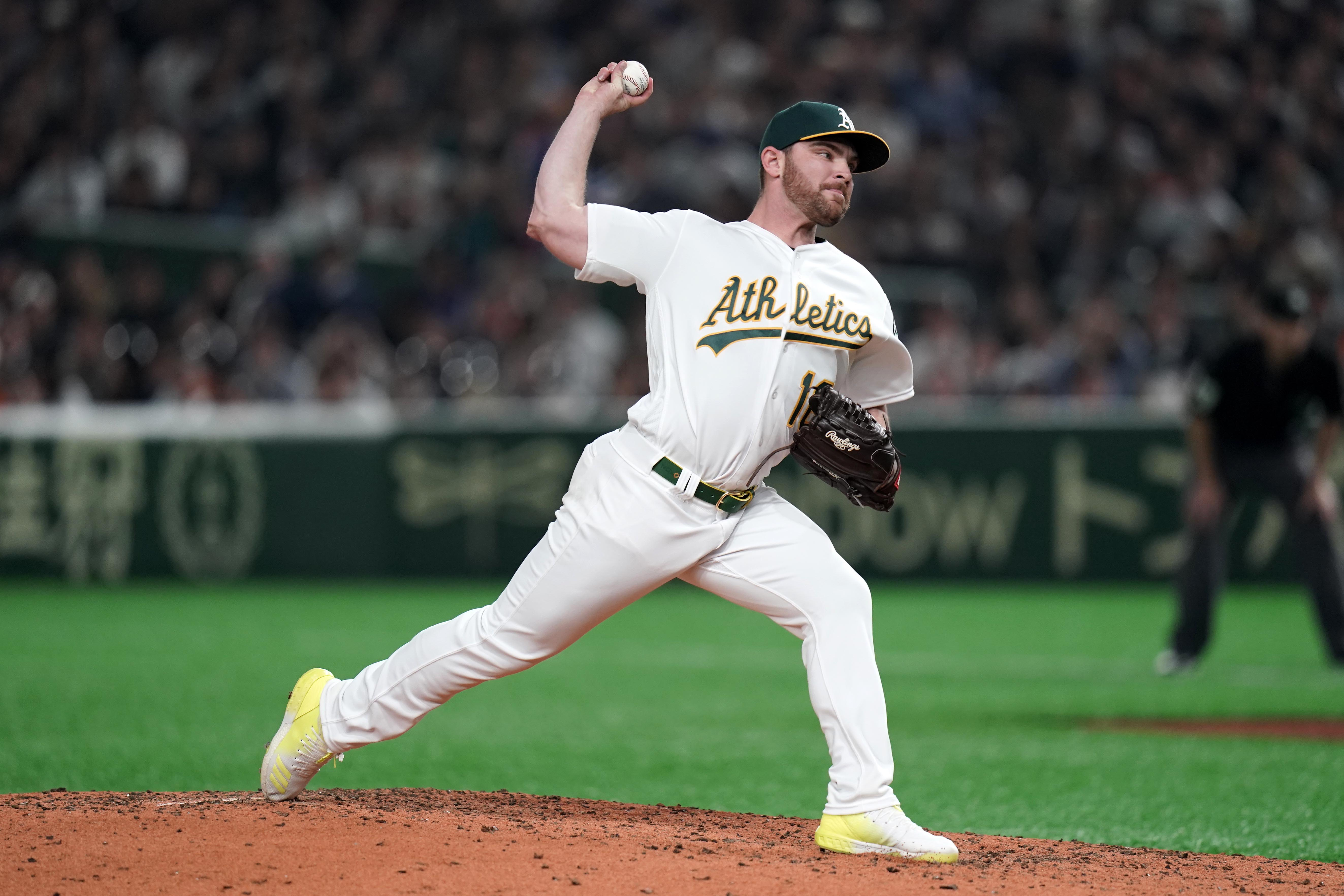 TOKYO, JAPAN - MARCH 20: Pitcher Liam Hendriks #16 of the Oakland Athletics throws in the 4th inning during the game between Seattle Mariners and Oakland Athletics at Tokyo Dome on March 20, 2019 in Tokyo, Japan. (Photo by Masterpress/Getty Images)