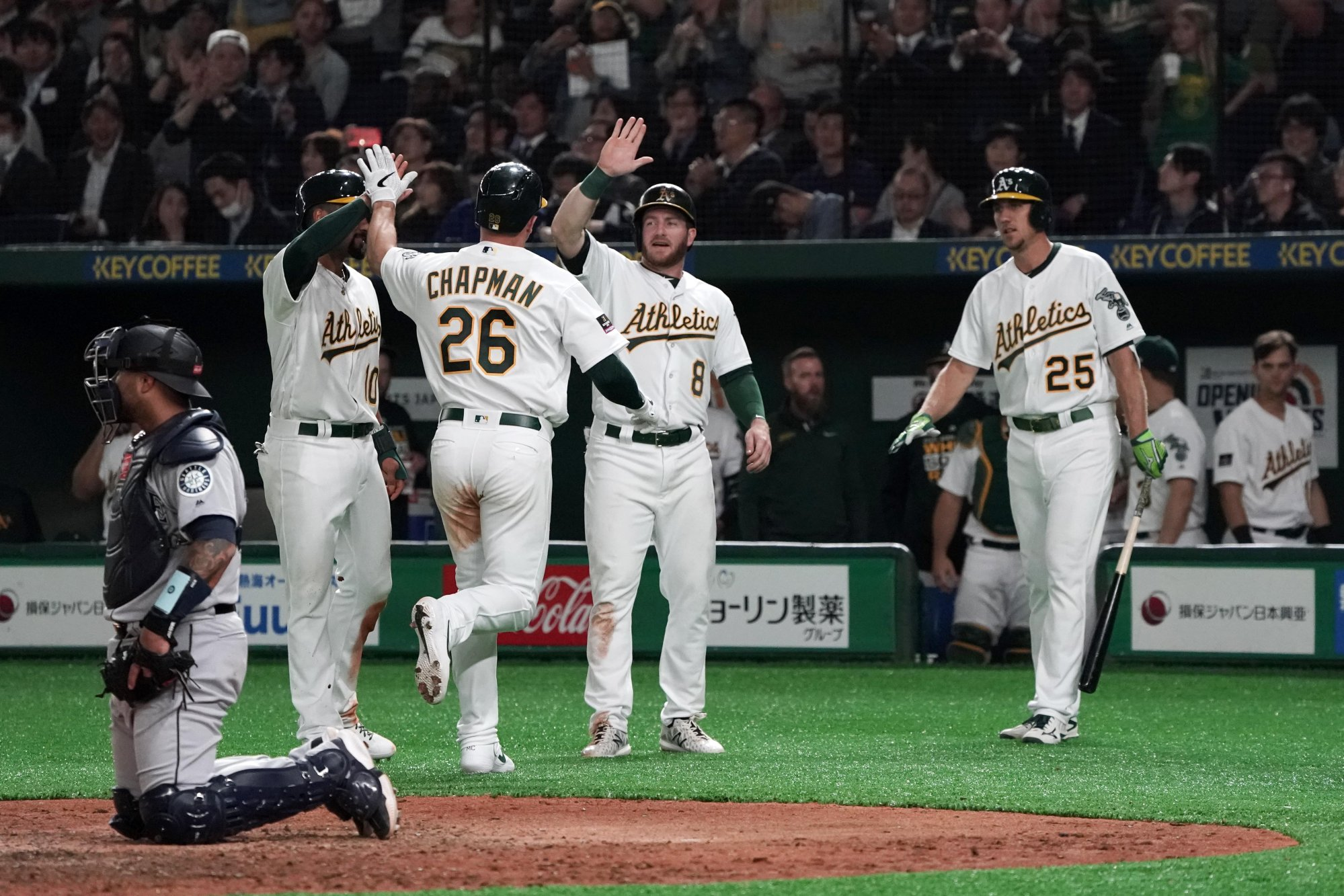 TOKYO, JAPAN - MARCH 20: Infielder Matt Chapman #26 of the Oakland Athletics is congratulated by his team mates after hitting a three-run home run to make it 9-7 in the 7th inning during the game between Seattle Mariners and Oakland Athletics at Tokyo Dome on March 20, 2019 in Tokyo, Japan. (Photo by Masterpress/Getty Images)