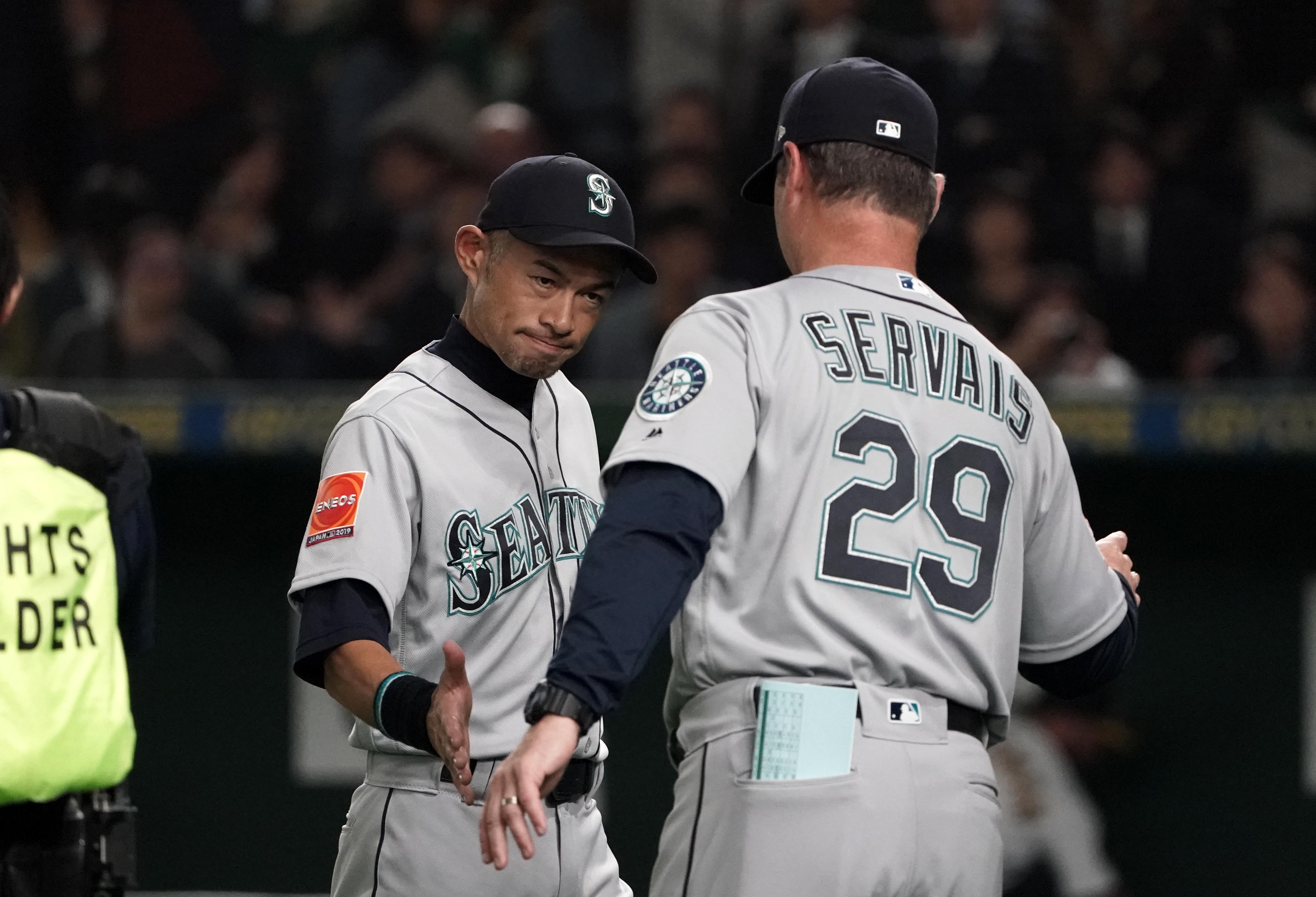 TOKYO, JAPAN - MARCH 20: Outfielder Ichiro Suzuki #51 and Head coach Scott Servais #29 of the Seattle Mariners celebrate their victory in the game between Seattle Mariners and Oakland Athletics at Tokyo Dome on March 20, 2019 in Tokyo, Japan. (Photo by Masterpress/Getty Images)