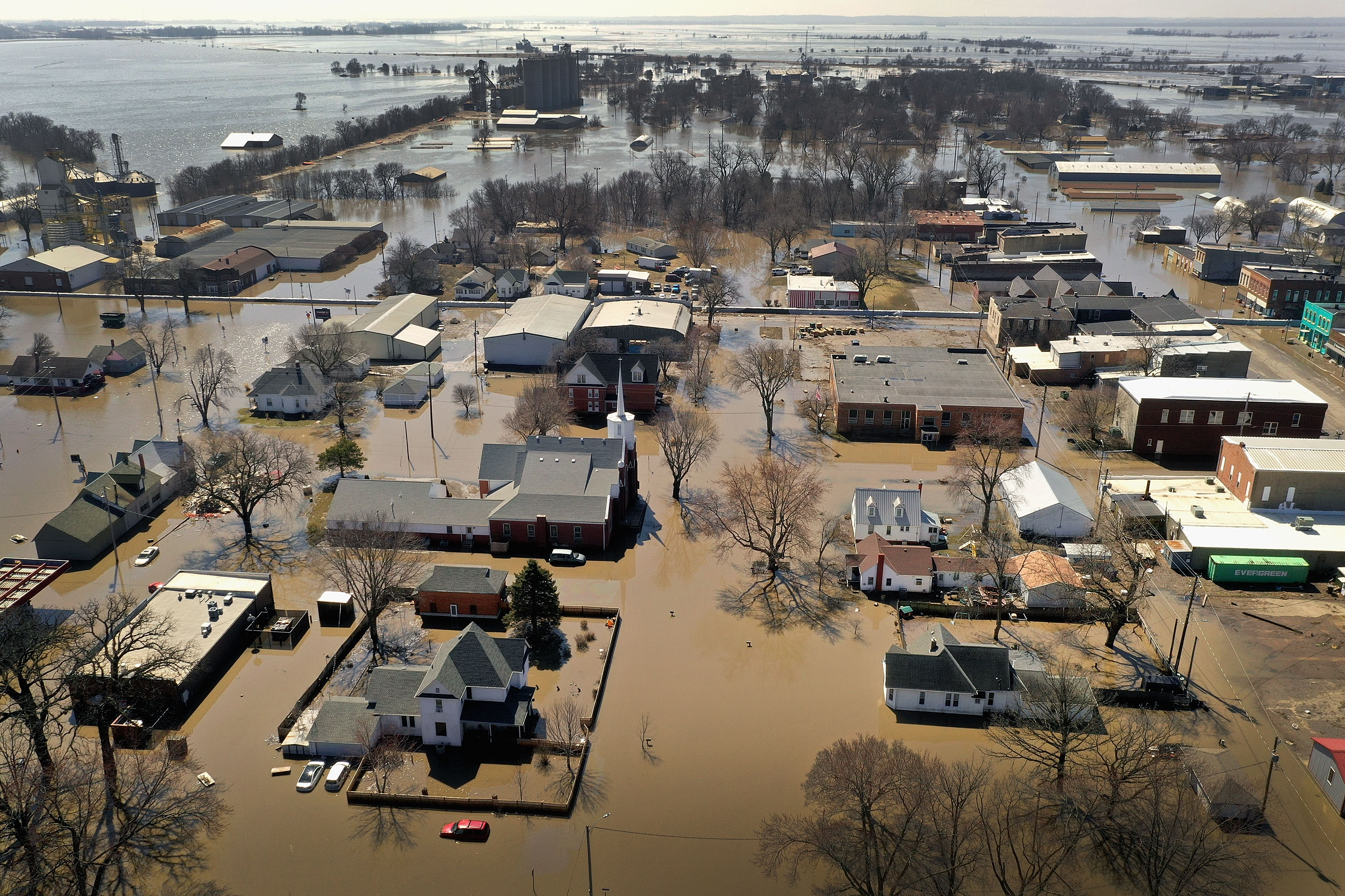 """HAMBURG, IOWA - MARCH 20:  Homes and businesses are surrounded by floodwater on March 20, 2019 in Hamburg, Iowa. Several Midwest states are battling some of the worst flooding they have experienced in decades as rain and snow melt from the recent """"bomb cyclone"""" has inundated rivers and streams. At least three deaths have been linked to the flooding.  (Photo by Scott Olson/Getty Images)"""