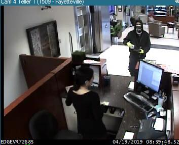 Surveillance photos show the suspect in an armed robbery at Centennial Bank on MLK Boulevard on April 19, 2019. (Courtesy of the Fayetteville Police Department)