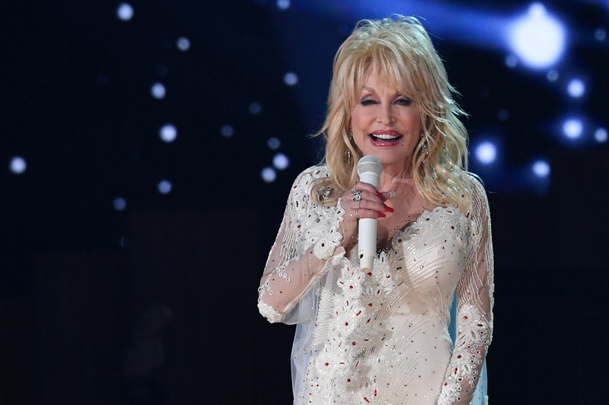 FBI Honors Dolly Parton For Work Following Great Smoky