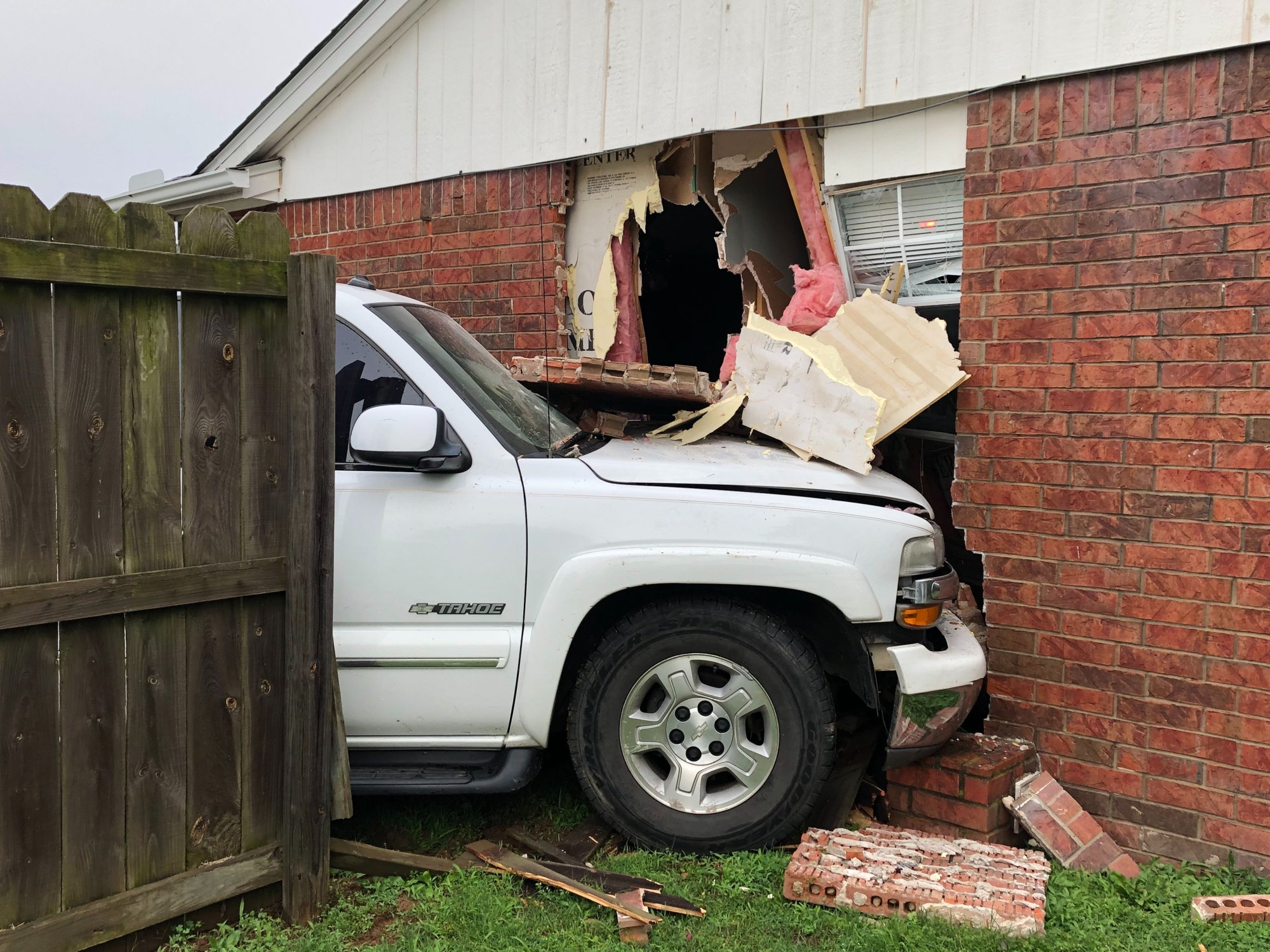 A white Chevrolet Tahoe hit the side of a home on High Avenue in Fayetteville on Thursday, May 30, 2019. (KFSM)