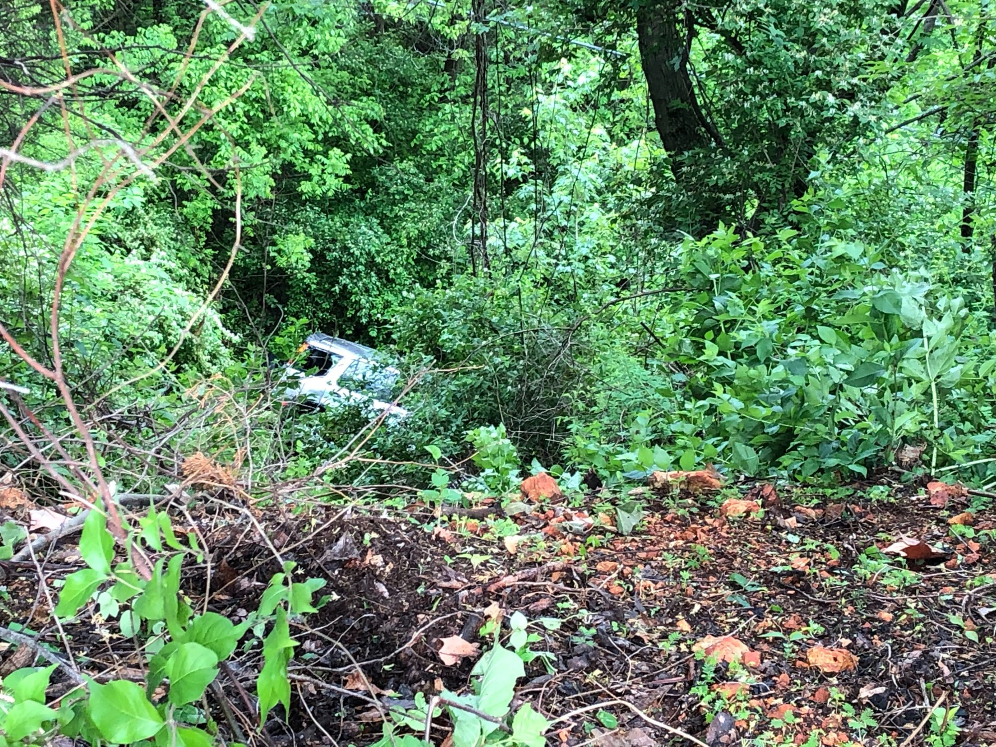 An SUV drove off a cliff behind the Northwest Arkansas Mall in Fayetteville on May 2, 2019. (KFSM)