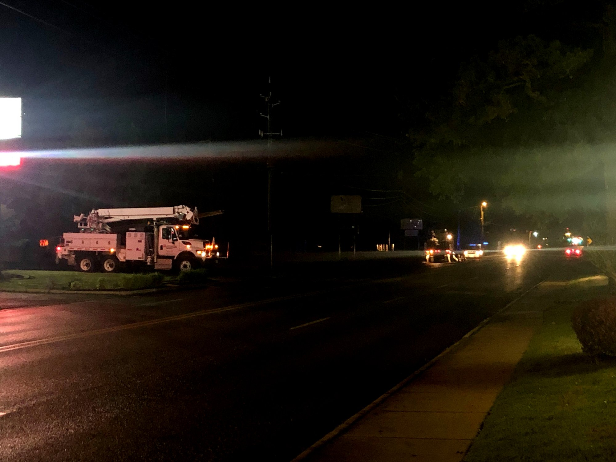 Crews from SWEPCO work to restore power along 13th Street in Rogers on Thursday, May 2, 2019. (KFSM)