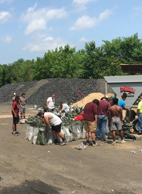 Spiro Football team making over 1,000 sandbags (Courtesy of David M Hogan II)