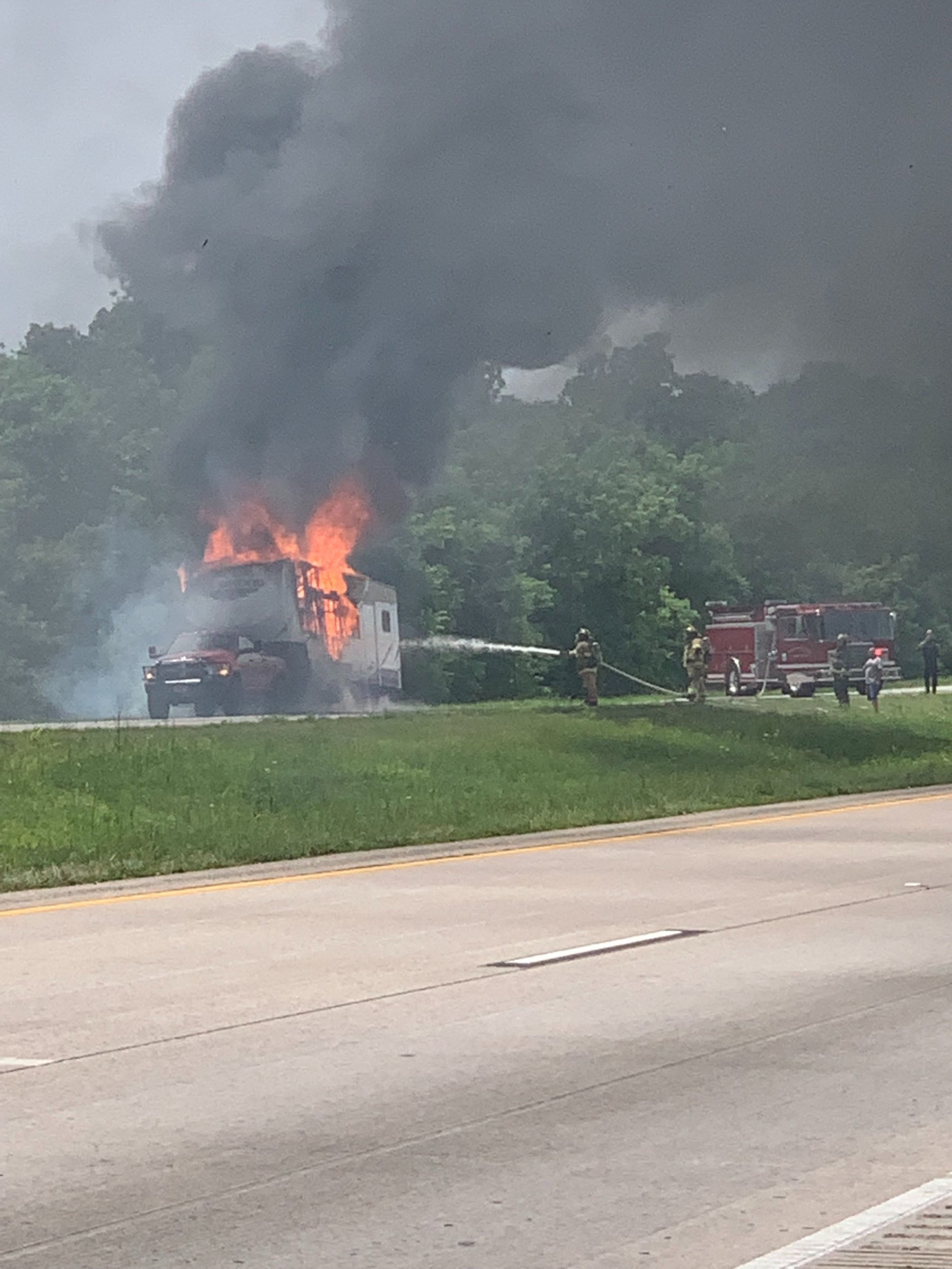 An RV caught fire on Interstate 49, closing the northbound lanes, on June 3, 2019. (Arbnor/Prelvukaj/KFSM)