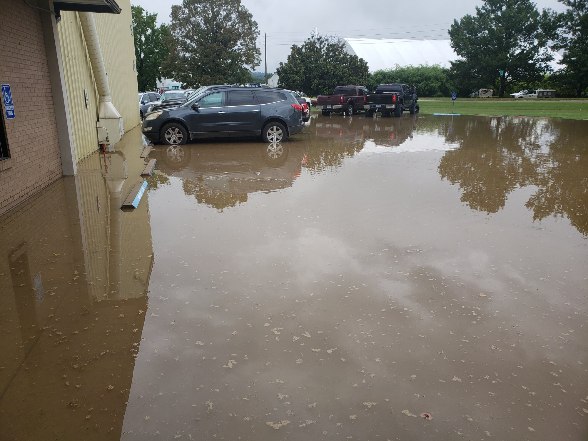 A massive water leak flooded the parking lot of Packaging Specialties in Fayetteville on Aug. 22, 2019.