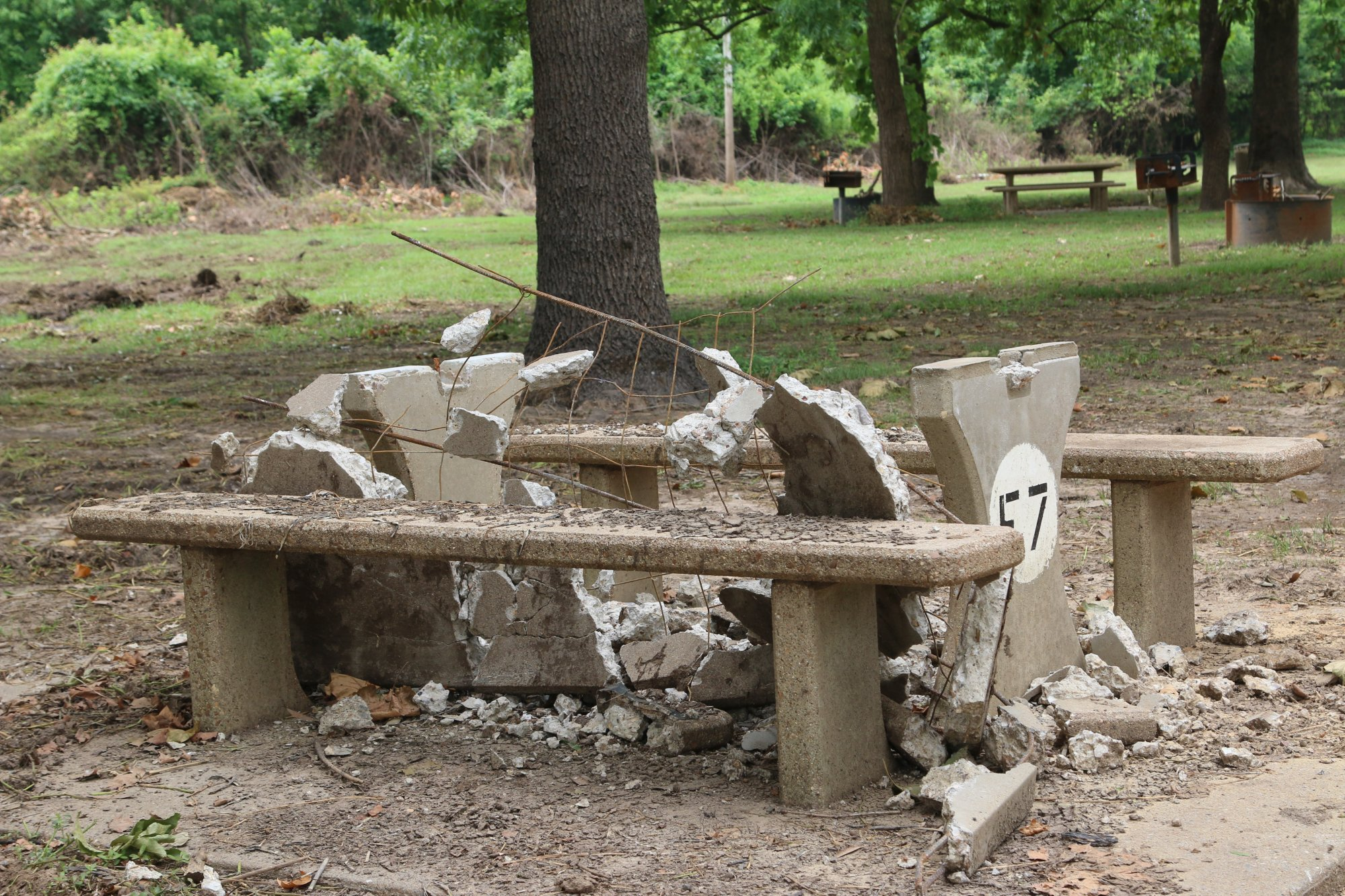 A picnic table lies mangled, one of many damaged during spring flooding.