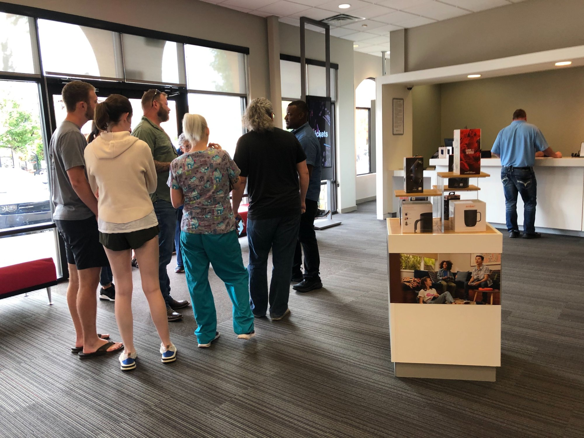 Customers waiting at the Fayetteville Verizon store