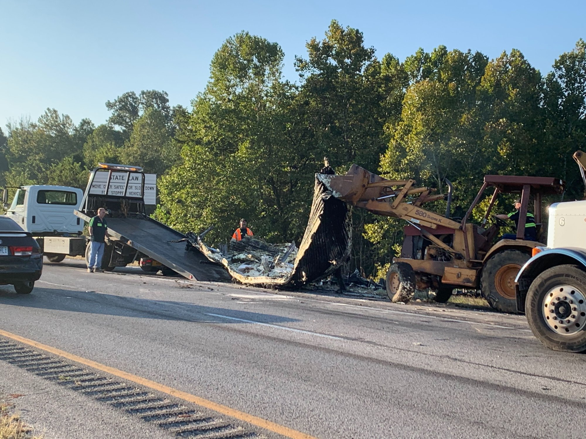 Crews work to clean up the wreckage of a semi that caught fire overnight near Bella Vista on Interstate 49 on Friday, Sept. 27, 2019. (Tiffany Lee/KFSM)