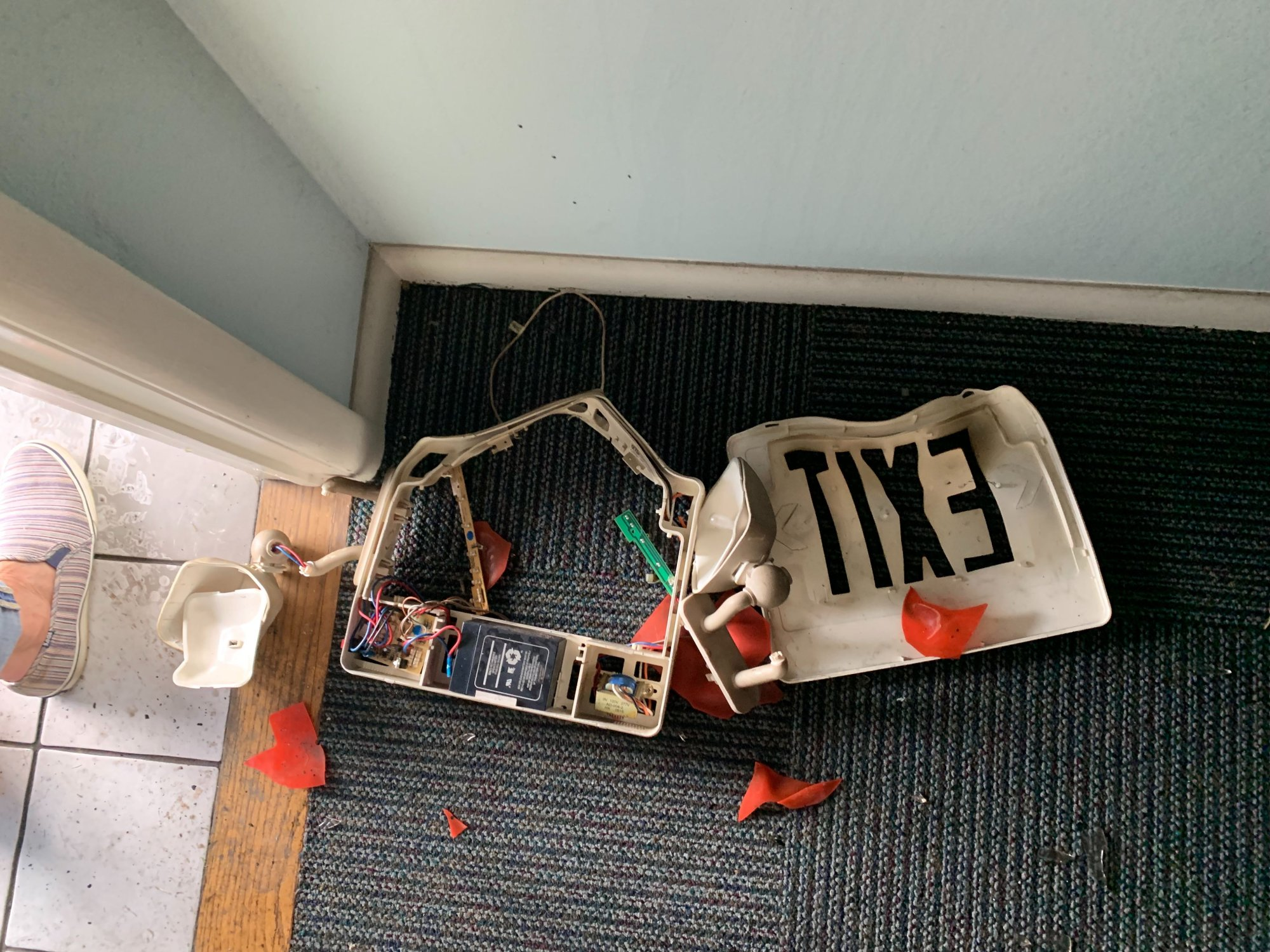 River Dental was vandalized overnight Tuesday, Sept. 10, 2019. Among the damage was this exit sign, which was knocked down and burned. (Tiffany Lee/KFSM)