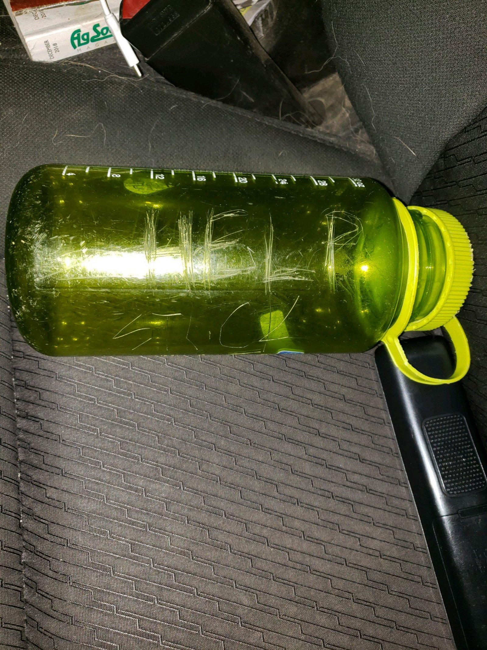 The family carved 'HELP' on a green bottle