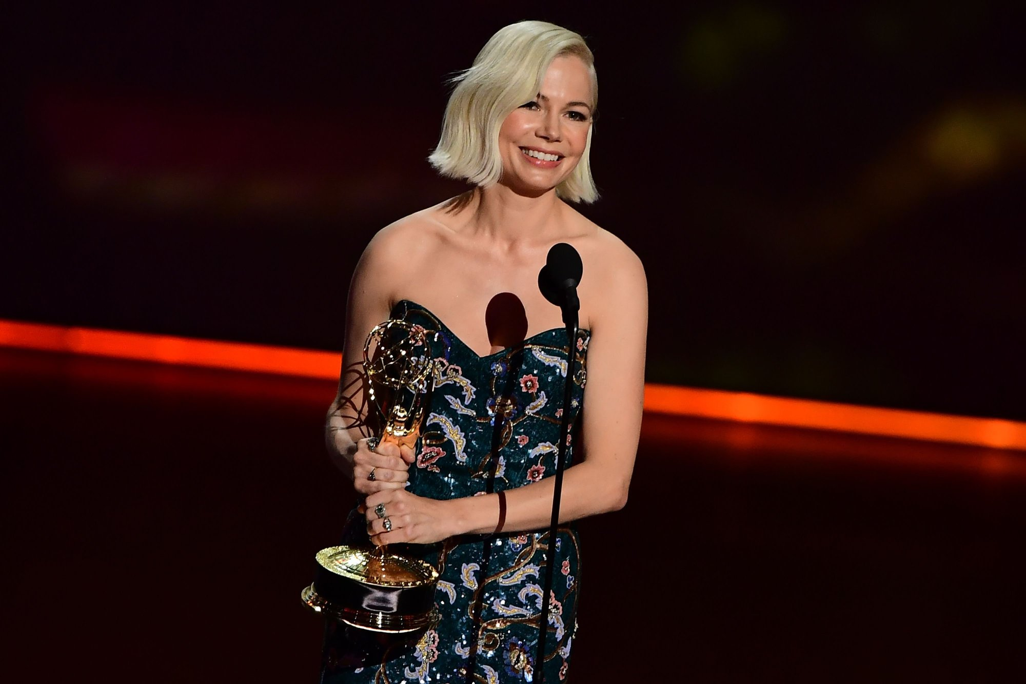 "Michelle Williams accepts the Outstanding Lead Actress in a Limited Series or Movie award for ""Fosse/Verdon"" onstage during the 71st Emmy Awards. Williams used her time on the Emmy stage to put out an impassioned call for gender pay parity and equality in the workplace."
