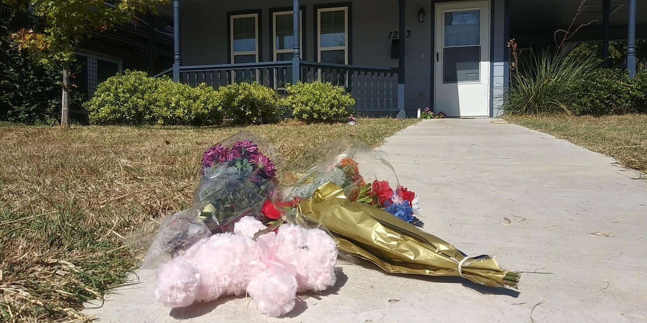 Flowers are laid out in front of the home where 28-year-old Atatiana Koquice Jefferson's was shot and killed by a white police officer in Fort Worth. (photo courtesy of CNN)