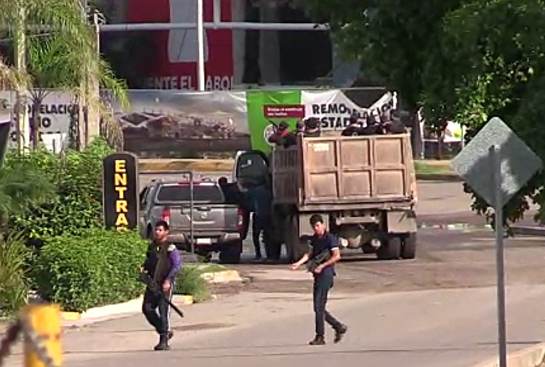 Gunmen are seen in a Culiacan street Thursday.