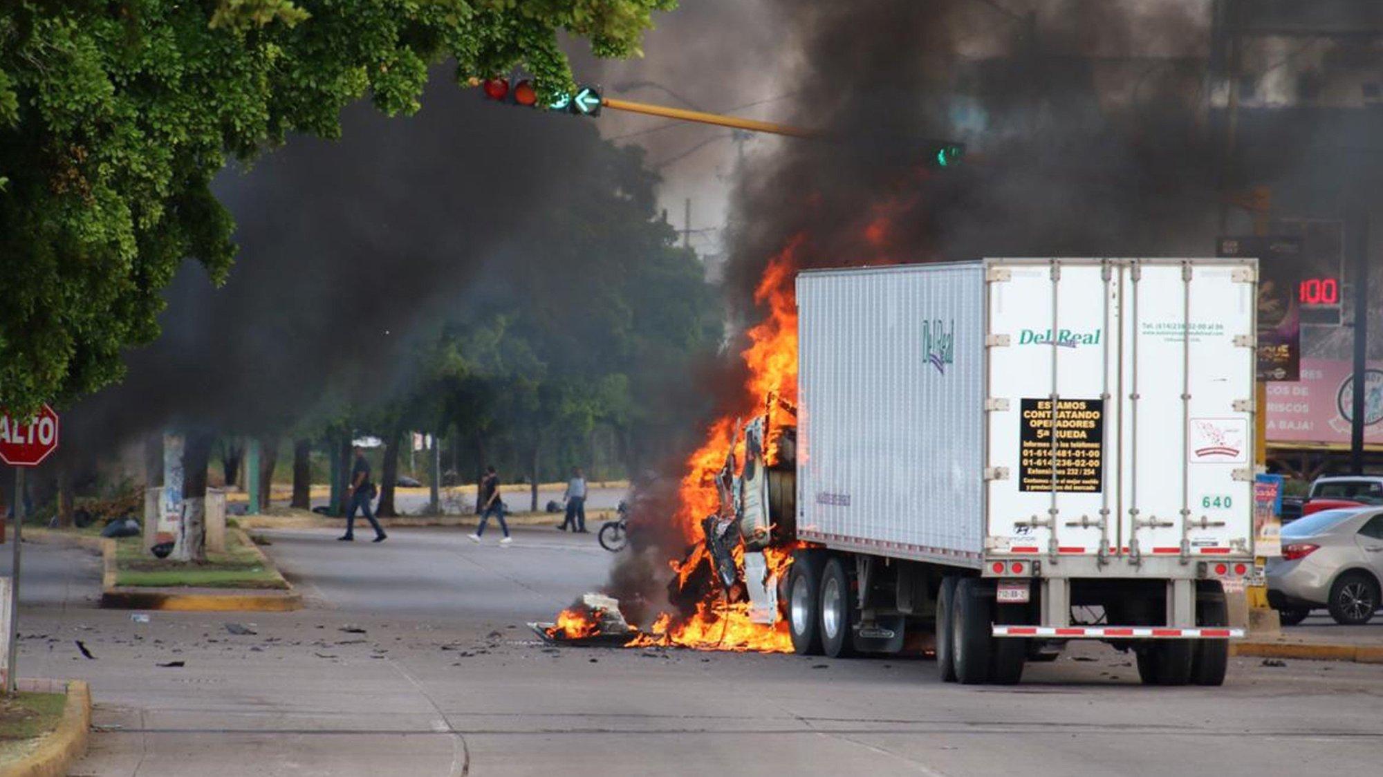 A truck burns in a Culiacan street during Thursday's battle.