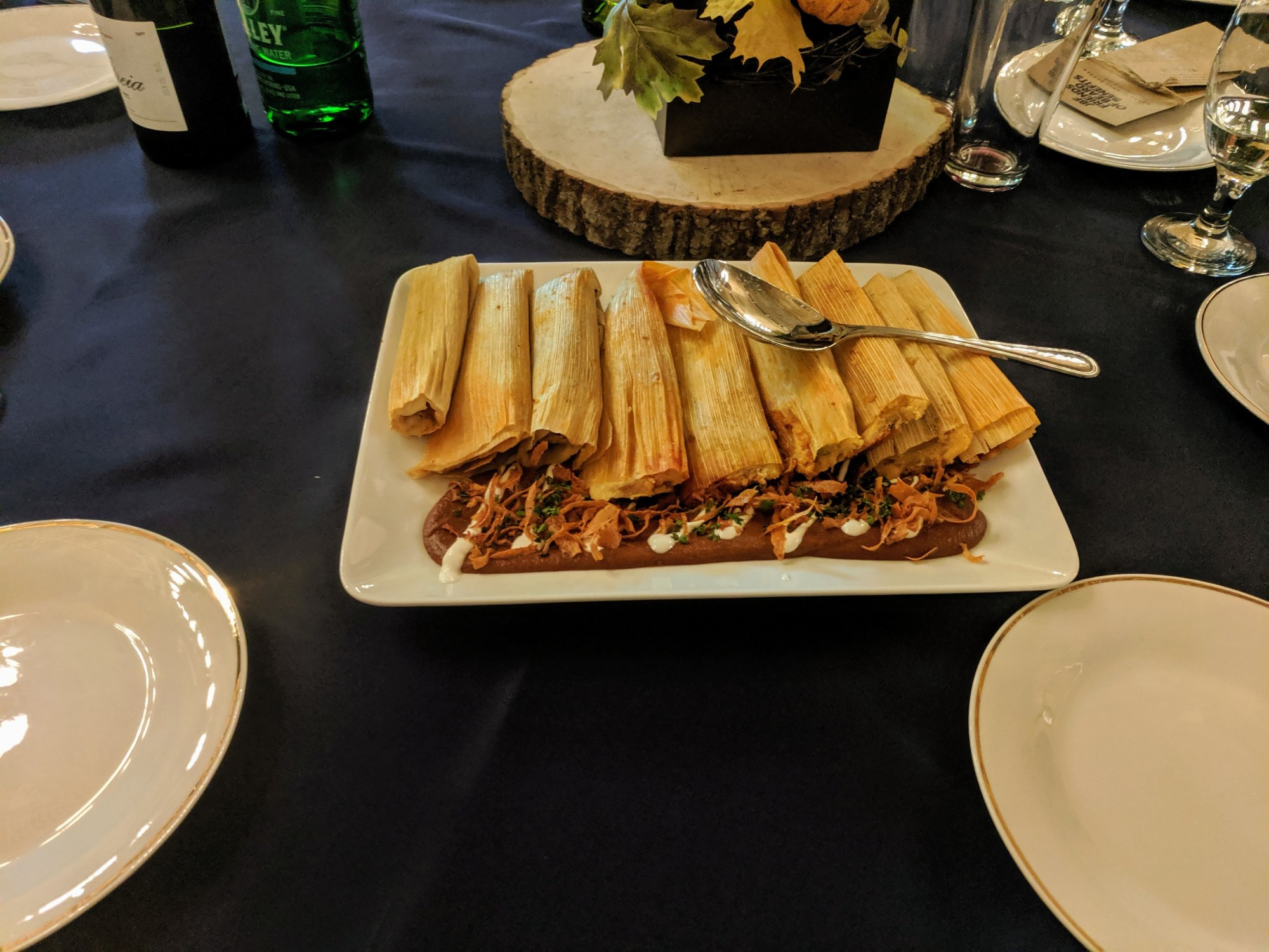 Delta style duck tamales, chili-pear mole, crispy parsnip.
