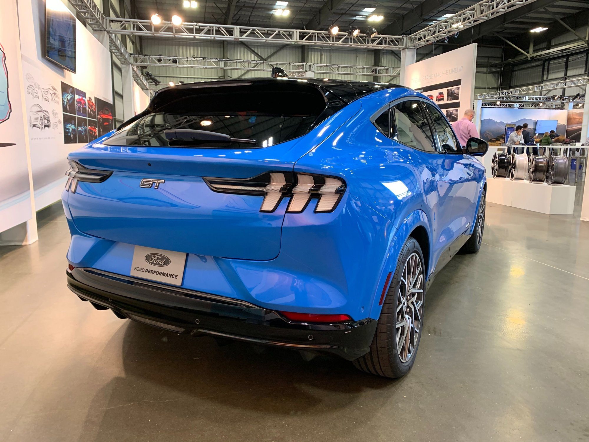 The Ford Mustang Mach-E's taillights are widely spread out to accentuate the crossover SUV's width.