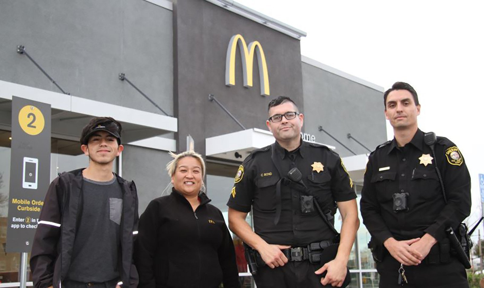 McDonalds's workers rescue woman who mouths 'help me' '